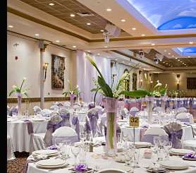 A hotel function suite featuring energy saving downlights, wall lights, concealed ceiling lighting and colour co-ordinated background music speakers