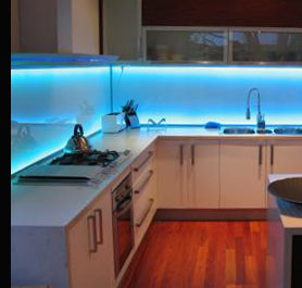 A Kitchen fitted with remote controled colour-changing LED under-unit strip lighting
