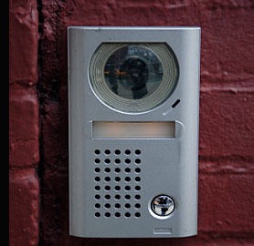 A typical door entry system incuding minature camera